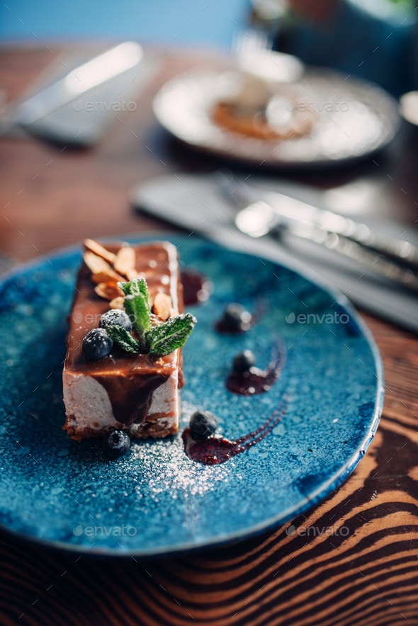 Sweet dessert on a plate on wooden table, nobody - Stock Photo - Images