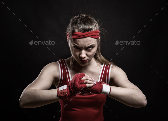 Female kickboxer training in gym, boxing workout - Stock Photo - Images
