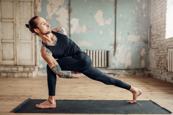 Male yoga doing flexibility exercise - Stock Photo - Images