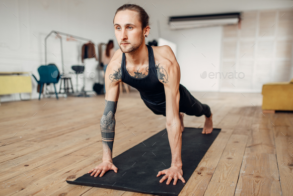 Male yoga doing push up exercise - Stock Photo - Images