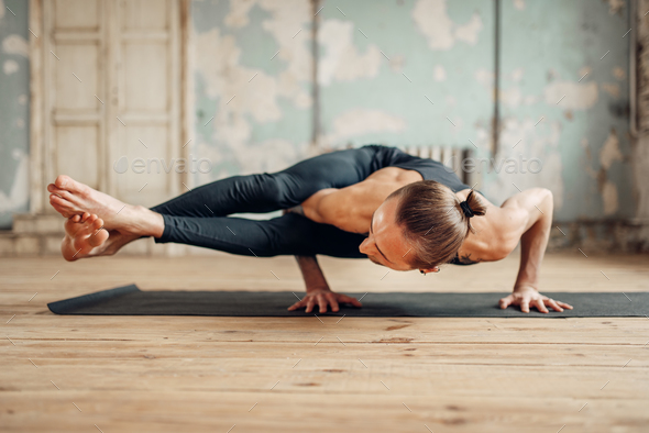 Yoga standing on hands, balance and press training - Stock Photo - Images