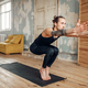 Male yoga doing balance exercise on mat in gym - PhotoDune Item for Sale