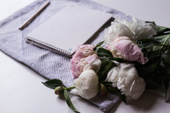 Notebook with bouquet peonies - Stock Photo - Images