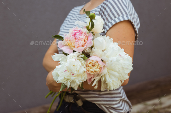 Girl with pink and white peonies bouquet - Stock Photo - Images