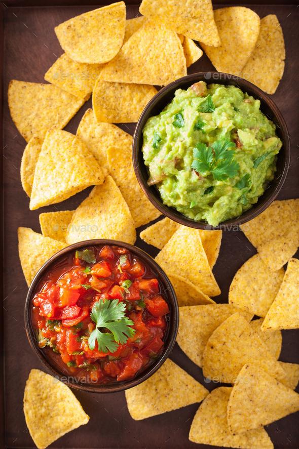 mexican guacamole and salsa dip, nachos tortilla chips - Stock Photo - Images