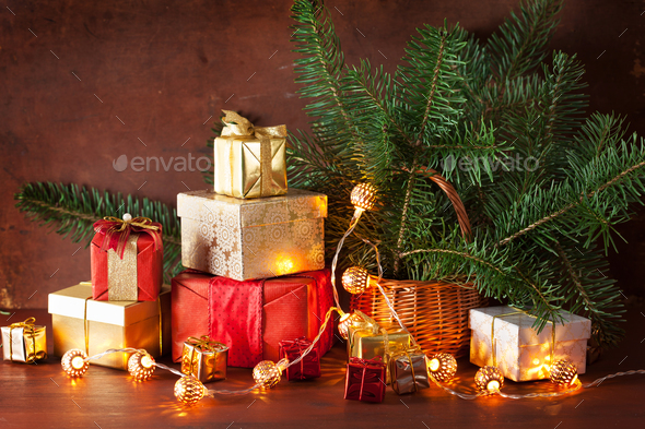 red and golden christmas gift box and decoration light - Stock Photo - Images