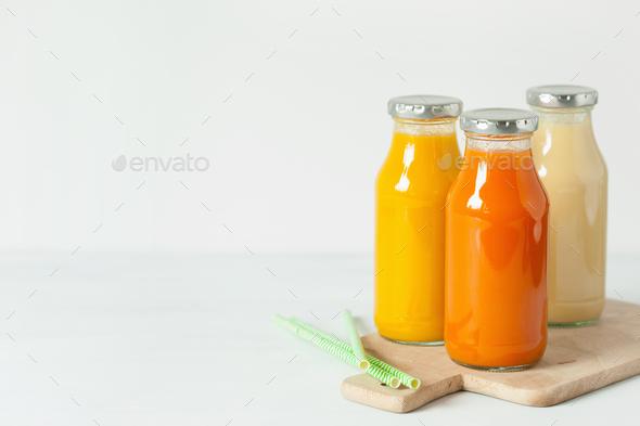 fruit and vegetable smoothies in glass jars, orange mango banana - Stock Photo - Images