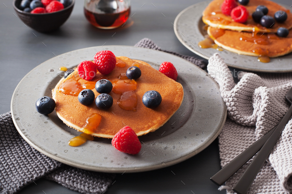 pancakes with blueberry raspberry honey and jam for breakfast - Stock Photo - Images