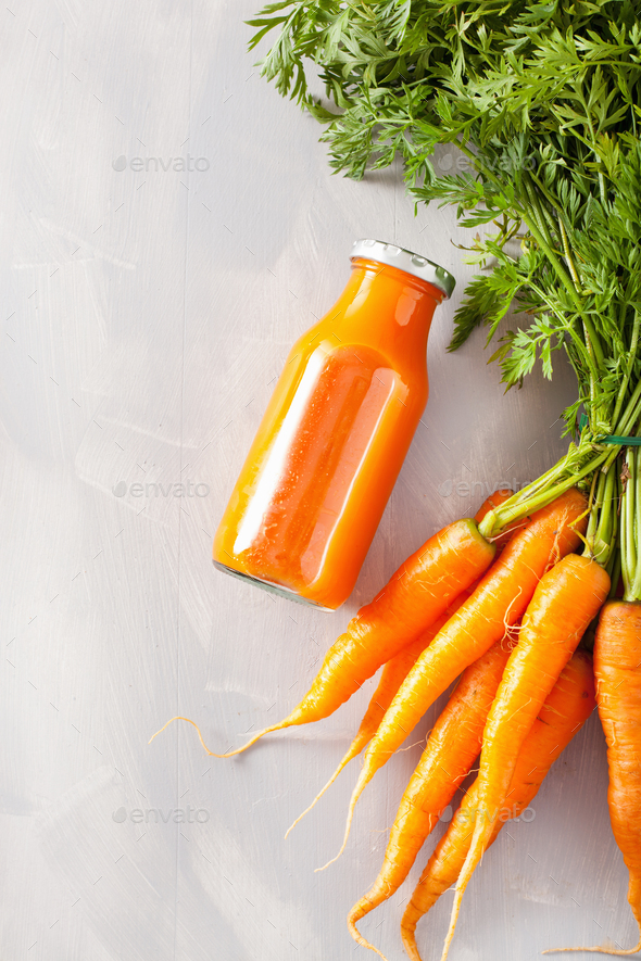fruit and vegetable smoothie in glass jar, orange carrot - Stock Photo - Images