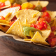 nachos loaded with salsa, guacamole, cheese and jalapeno - PhotoDune Item for Sale