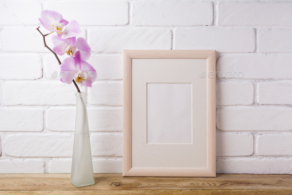 Wooden frame mockup with tender pink orchid - Stock Photo - Images