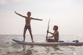 Happy children playing on the beach at the day time. - PhotoDune Item for Sale