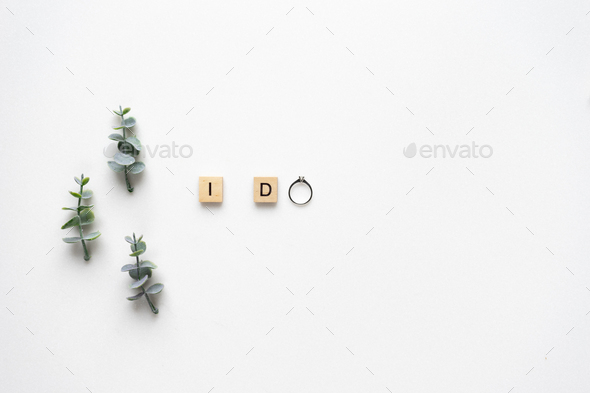 Wooden letters  spelling I do with engagement ring, oregano bran - Stock Photo - Images