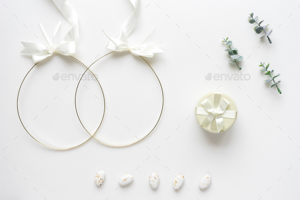 Wedding crowns, oregano branches, candys and box  on white marbl - Stock Photo - Images