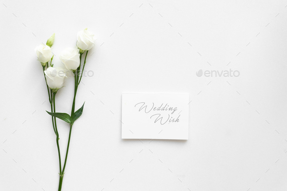 Wedding wish card with roses, on white marble. Top view. - Stock Photo - Images