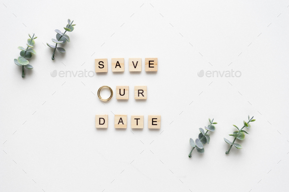 Wooden letters  spelling save our date, oregano branches and wed - Stock Photo - Images