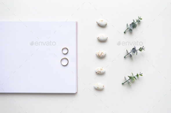 Wedding wish book, rings, candy and oregano branches on white ma - Stock Photo - Images