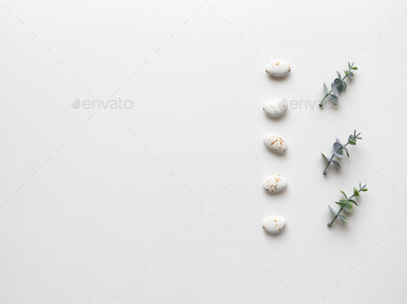 Oregano branches and wedding candys on white marble. Top view. - Stock Photo - Images