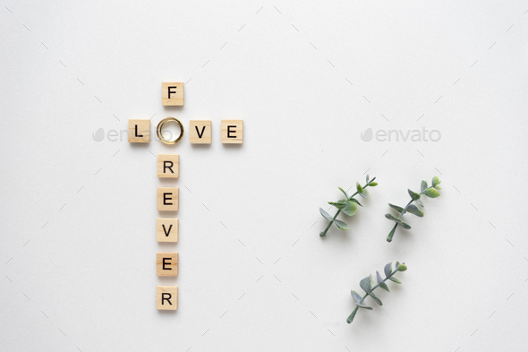 Wooden letters and wedding ring speling love for ever, with oreg - Stock Photo - Images