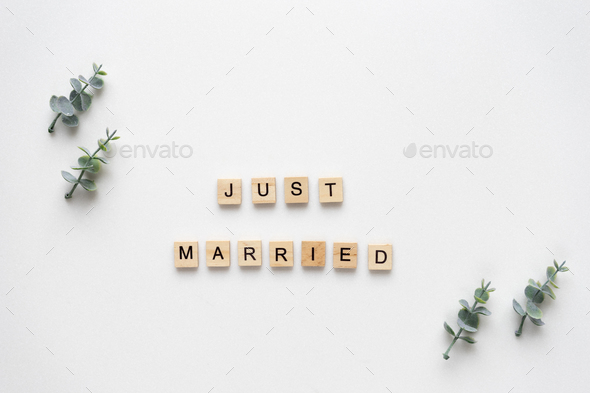 Wooden letters  speling just married with oregano branches on wh - Stock Photo - Images