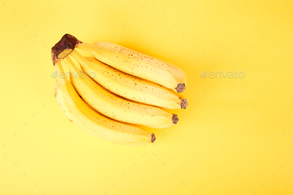 Banana on yellow paper background. - Stock Photo - Images