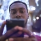 African American Man Using Business App on Smart Phone - VideoHive Item for Sale