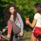 Two Female Cyclists Drink Water and Talk on Sunny Summer Day - VideoHive Item for Sale