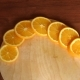 Juicy Sliced Orange on a Wooden Table - VideoHive Item for Sale