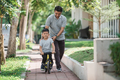 kid with his father learning how to ride a bicycle - PhotoDune Item for Sale