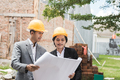 designers discussing house construction plan - PhotoDune Item for Sale
