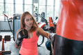 Attractive female punching a bag - PhotoDune Item for Sale