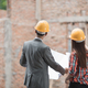 designers discussing construction plan - PhotoDune Item for Sale