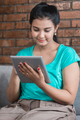 Casual woman using tablet at home - PhotoDune Item for Sale