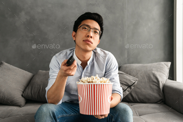 Portrait of a bored young asian man - Stock Photo - Images