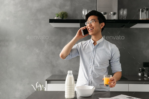 Portrait of a happy young asian man - Stock Photo - Images