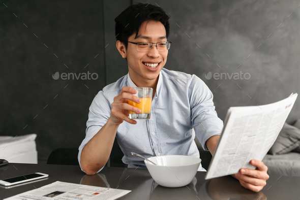 Portrait of a friendly young asian man - Stock Photo - Images