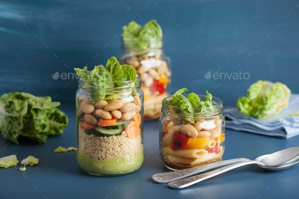 vegan couscous and pasta salad in mason jars with vegetables bea - Stock Photo - Images