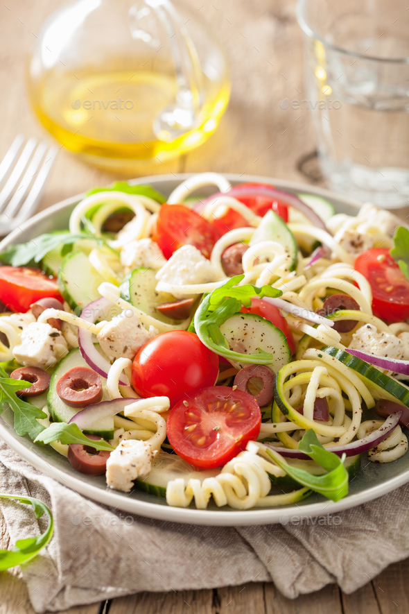 spiralized courgette salad greek style with tomato feta olives c - Stock Photo - Images