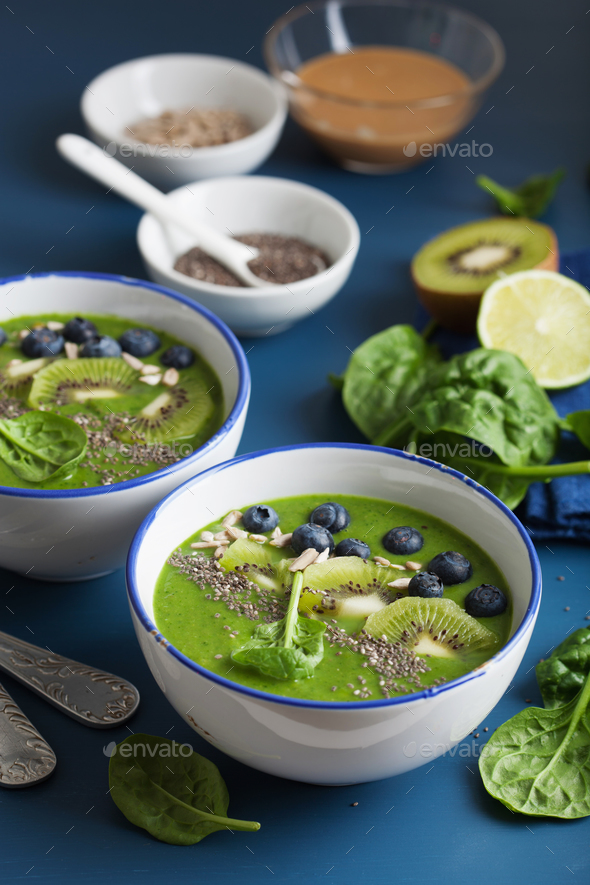green smoothie bowl spinach kiwi blueberry lime banana with chia - Stock Photo - Images