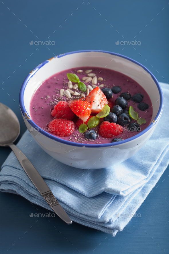 healthy berry smoothie bowl with strawberry blueberry raspberry - Stock Photo - Images