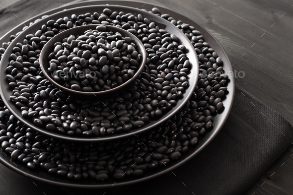 black turtle beans legumes in bowls - Stock Photo - Images
