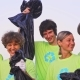 Five Young Volunteers in Green T-shirts with Image Recycle, Collect Garbage on an Oceanic Beach - VideoHive Item for Sale