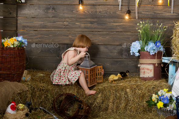 Little girl in a village house - Stock Photo - Images