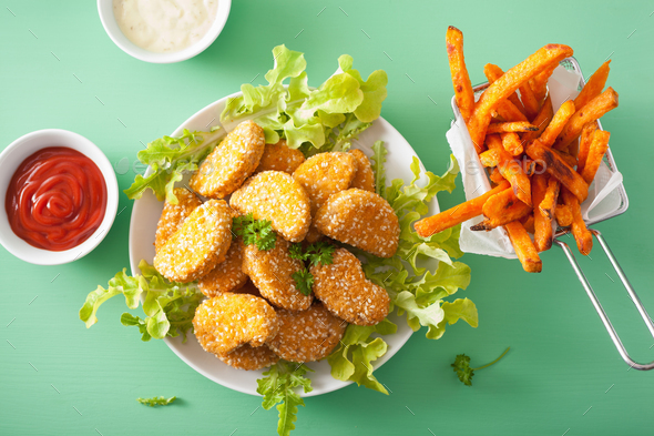 vegan soy nuggets and sweet potato fries healthy meal - Stock Photo - Images