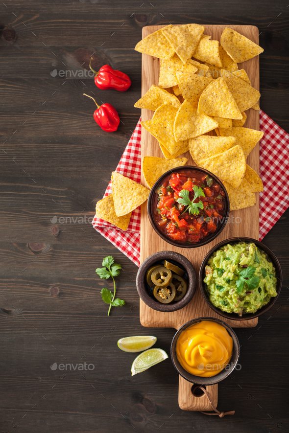 mexican nachos tortilla chips with guacamole, salsa and cheese d - Stock Photo - Images