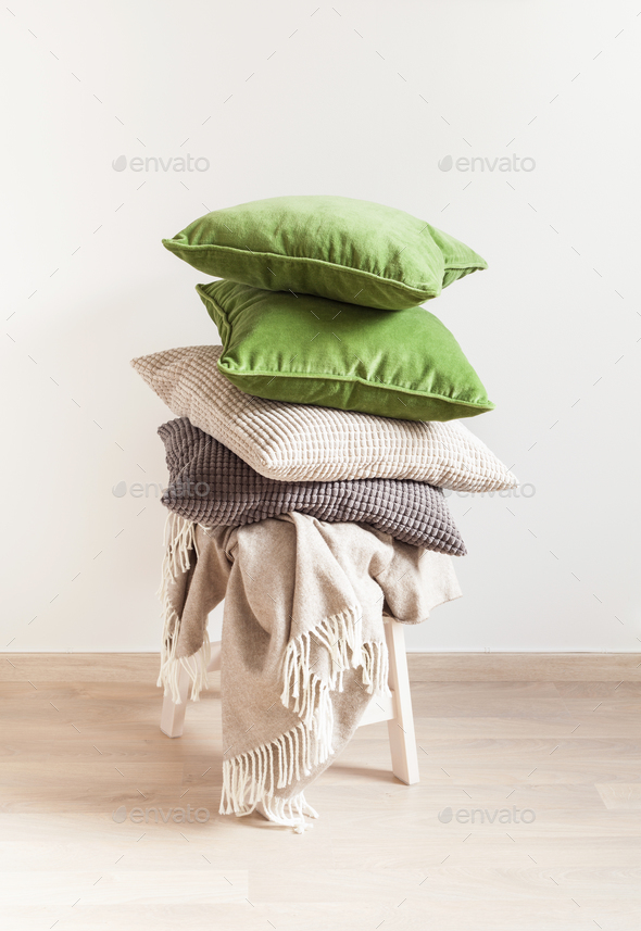 gray and green cushions, throw. cozy home - Stock Photo - Images