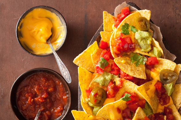 nachos loaded with salsa, cheese and jalapeno - Stock Photo - Images