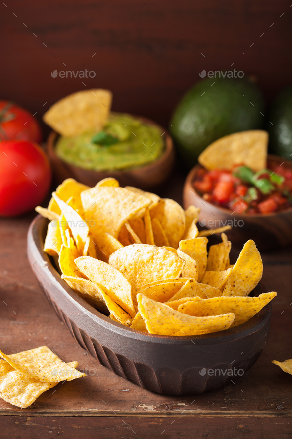 mexican guacamole and salsa dip with nachos tortilla chips - Stock Photo - Images