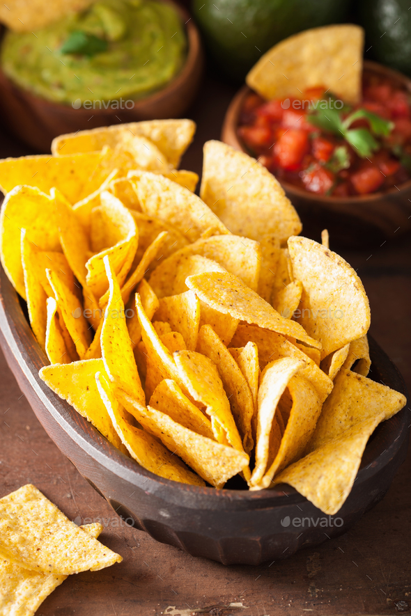 mexican nachos tortilla chips, guacamole and salsa dip - Stock Photo - Images