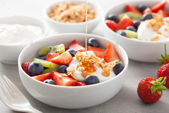 fruit berry salad with yogurt and granola for healthy breakfast - Stock Photo - Images